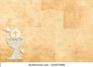 First holy communion invitation card. Silver chalice and doves on paper background with copy space to text and photo.