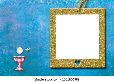 First holy communion invitation card. Cuter chalice on blue paper background with golden picture frame to text and photo.