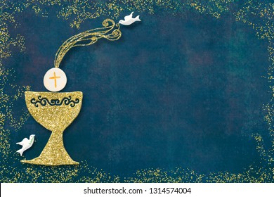 First holy communion invitation card.Golden chalice and doves on blue paper background with copy space to text and photo.