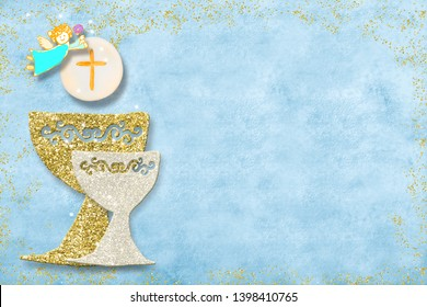 First holy communion invitation card.Golden and silver chalice and angel on blue paper background with copy space to text and photo.