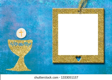First Holy Communion invitations, gold chalice and gold photo frame on blue  background with empty space for text and photos