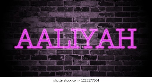 first name Aaliyah in pink neon on brick wall