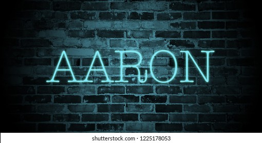 first name aaron in blue neon on brick wall