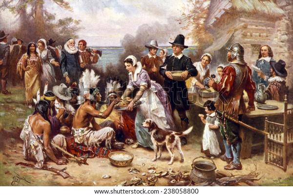 Le premier Thanksgiving, 1621, les pèlerins et les indigènes se réunissent pour partager un repas, une peinture à l'huile de Jean Louis Gerome Ferris, 1932.