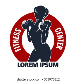 Fitness Club or Gym emblem with training muscled woman. Woman holds dumbbells. Only free font used. Isolated on white background.