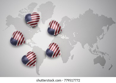five hearts with national flag of united states of america on a world map background..concept.3D illustration