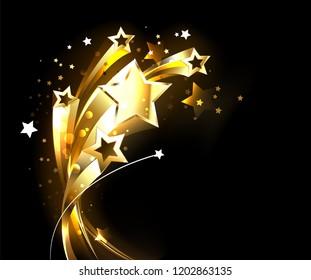 Five soaring, golden, shining stars on black background.