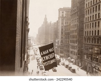 Flag announcing another lynching. 'A MAN WAS LYNCHED YESTERDAY,' is flown from the window of the NAACP headquarters on 69 Fifth Ave., New York City in 1936.