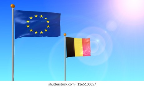 The flag of Belgium, a member of the European Union on the shaft, develops in the wind in the sun with a glare from the lens on a blue background.