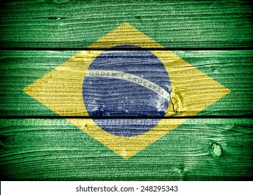 flag of Brazil painted on old grungy wooden  background