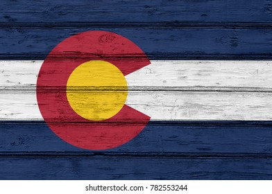 Flag of Colorado state (USA) on wood texture background