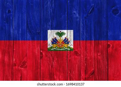 Flag of Haiti on wooden background