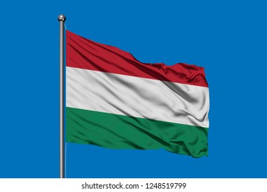Flag of Hungary waving in the wind against deep blue sky. Hungarian flag.