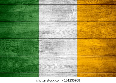 flag of Ireland or Irish banner on wooden background