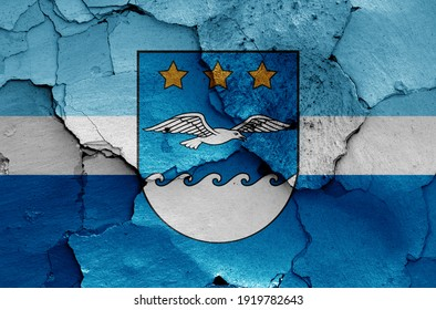 flag of Jurmala painted on cracked wall