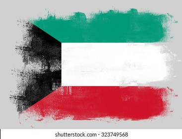 Flag of Kuwait painted with brush on solid background,