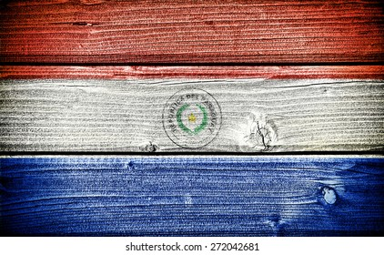 flag of Paraguay painted on old grungy wooden  background