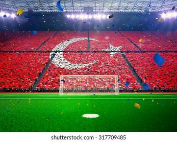 Flag Turkey of fans. Evening stadium arena Blue