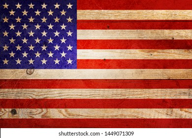 Flag of United States of America on background of old scratched planks.
