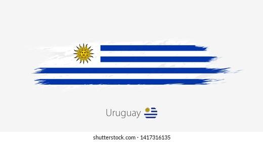 Flag of Uruguay, grunge abstract brush stroke on gray background. Vector illustration.