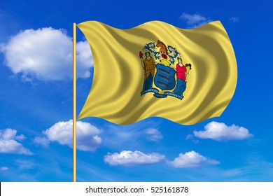 Flag of the US state of New Jersey. American patriotic element. USA banner. United States of America symbol. New Jerseyan official flag on flagpole waving in wind, blue sky background. Fabric texture