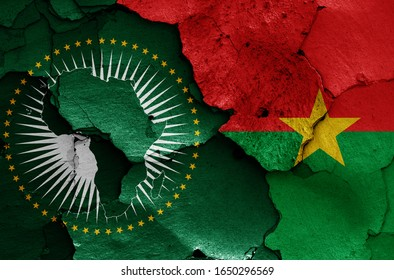 flags of African Union and Burkina Faso painted on cracked wall