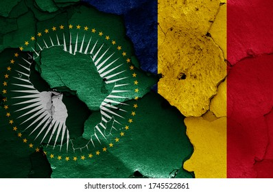 flags of African Union and Chad painted on cracked wall