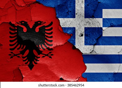 flags of Albania and Greece painted on cracked wall