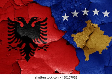 flags of Albania and Kosovo painted on cracked wall