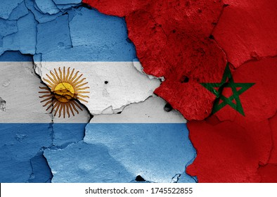 flags of Argentina and Morocco painted on cracked wall
