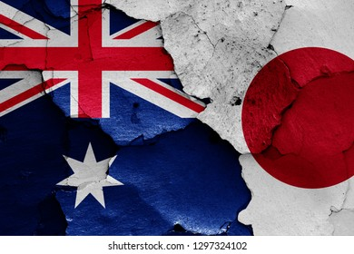 flags of Australia and Japan painted on cracked wall