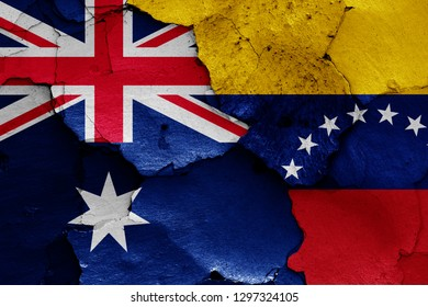 flags of Australia and Venezuela painted on cracked wall