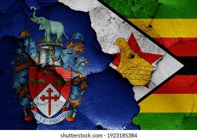 flags of Bulawayo and Zimbabwe painted on cracked wall