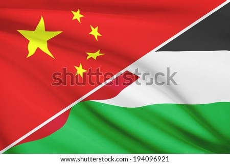 Flags of China and Hashemite Kingdom of Jordan blowing in the wind. Part of a series.