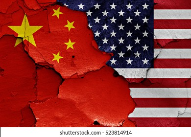flags of China and USA painted on cracked wall