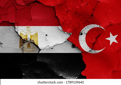 flags of Egypt and Turkey painted on cracked wall