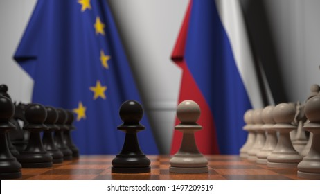 Flags of the EU and Russia behind chess board. The first pawn moves in the beginning of the game. Political rivalry conceptual 3D rendering