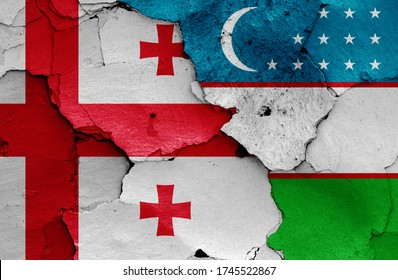 flags of Georgia and Uzbekistan painted on cracked wall