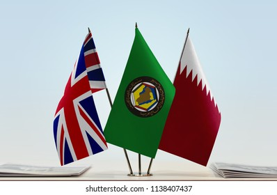 Flags of Great Britain GCC and Qatar. Cloth of flags is 3d rendering, the rest is a photo.