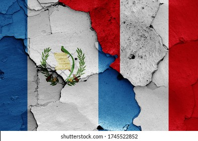 flags of Guatemala and Peru painted on cracked wall