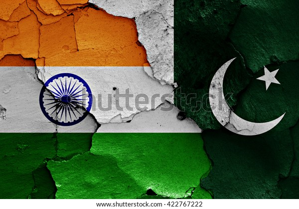 flags of India and Pakistan painted on cracked wall