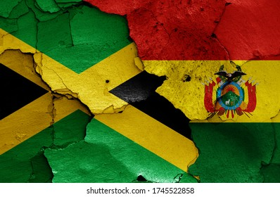 flags of Jamaica and Bolivia painted on cracked wall