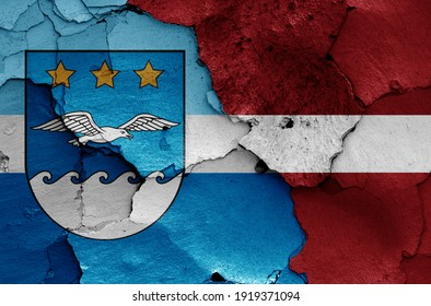 flags of Jurmala and Latvia painted on cracked wall