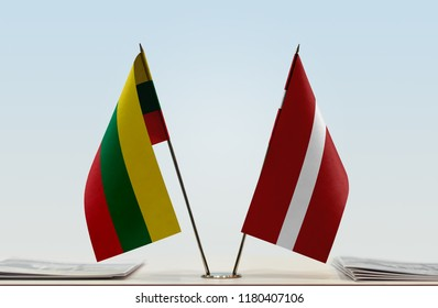 Flags of Lithuania and Latvia. Cloth of flags is 3d rendering, the rest is a photo.
