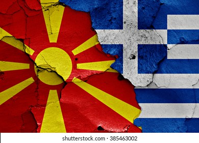 flags of Macedonia and Greece painted on cracked wall