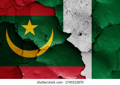 flags of Mauritania and Nigeria painted on cracked wall