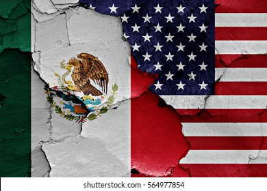 flags of Mexico and USA painted on cracked wall