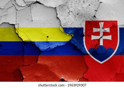 flags of Presov Region and Slovakia painted on cracked wall
