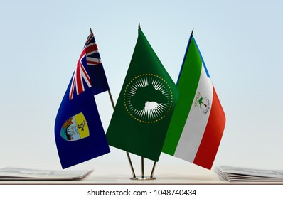 Flags of Saint Helena African Union and Equatorial Guinea. Cloth of flags is 3d rendering, the rest is a photo.