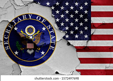 flags of Secretary of State and USA painted on cracked wall